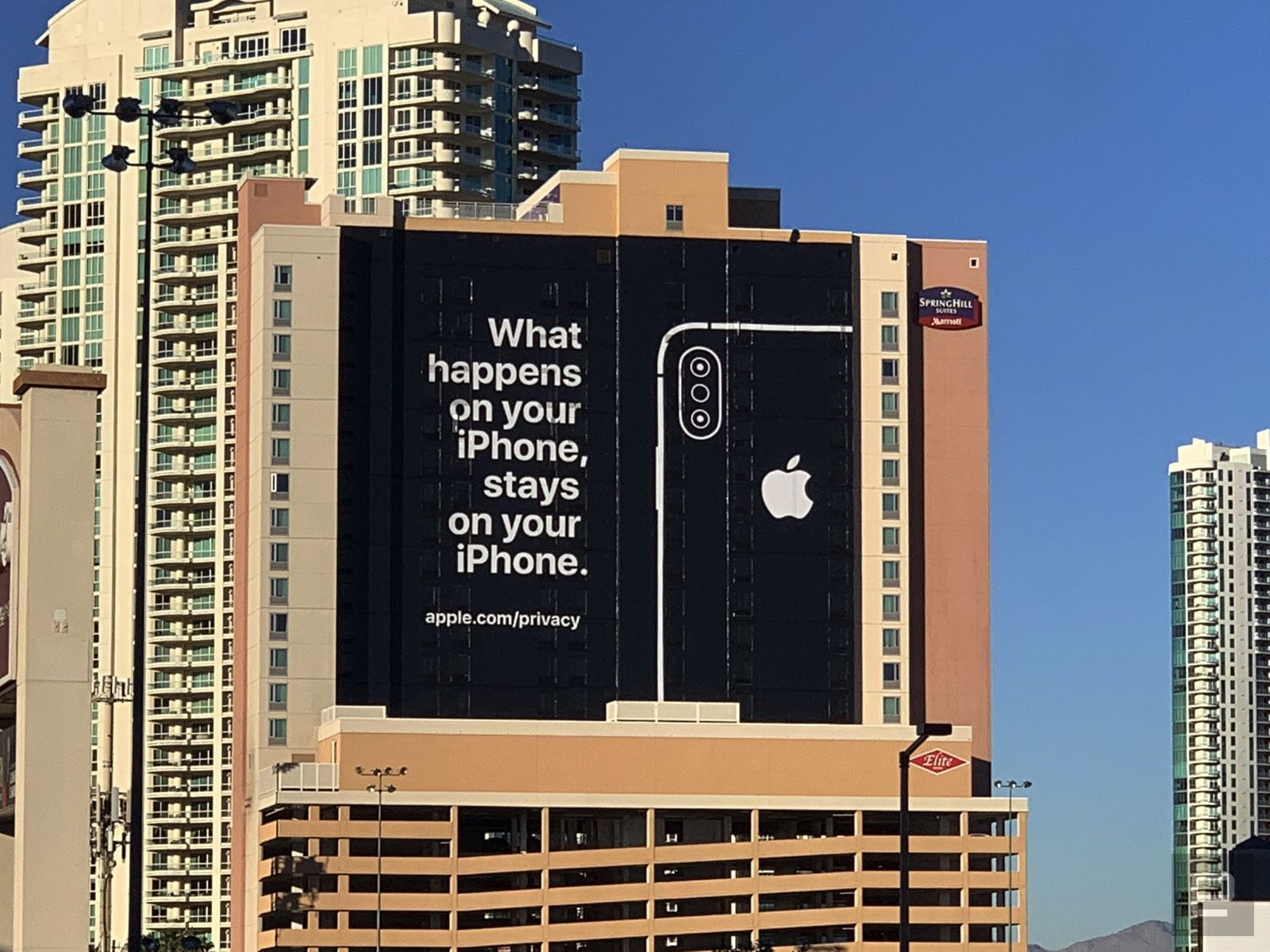 Apple ad on side of building during CES 2019. Reads: 'What happens on your iPhone, stays on your iPhone.'